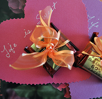 Dark chocolate with orange ribbon and heart