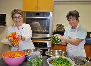 Extension Master Food Volunteers with vegetables for a class