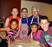 Extension Master Food Volunteer with cooking camp kids