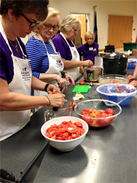 Extension Master Food Volunteers cutting tomatoes