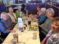 Extension Master Food Volunteers out to dinner together for a field trip