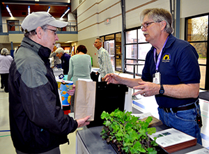 Master Gardener talking with customer at Healthy Yards Expo