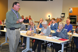 Horticulture agent Dennis Patton instructs EMG trainees during a classroom training session
