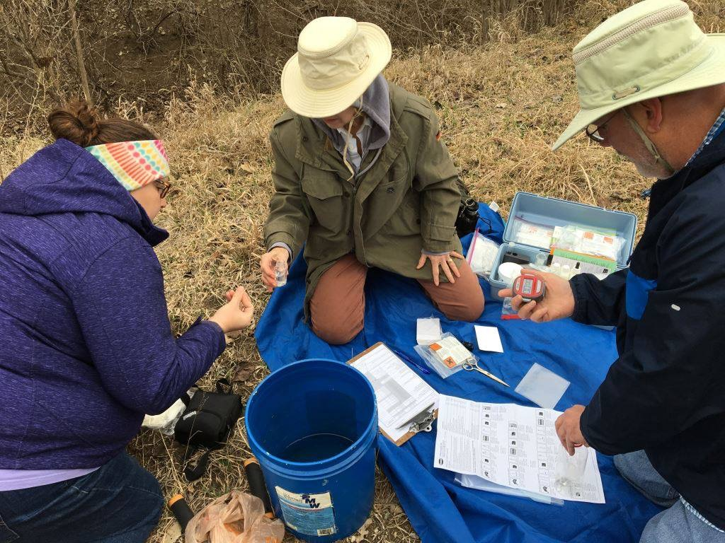 Naturalists testing water quality by Lou Pisani