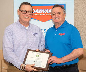 (l-r) Dennis Patton was presented the National Association of County Agricultural Agents communications award by Lance Walheim, national book author and garden expert for Bayer Advanced lawn and garden products